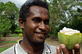 Close up image of Ministry of Agriculture Cocoa research officer Raymond Vava holding half a cocoa pod. (10686878245).jpg