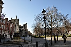View of College Green showing Queen Victoria statue, Cathedral and Council House, with restored cast iron lamp post in foreground
