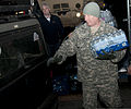 Command Sgt. Maj. Steve Deweese, assigned to Camp Dawson in Kingwood, W.Va., loads water into a vehicle at a Courthouse in Winfield, W.Va., Jan. 11, 2014 140111-Z-LQ742-010.jpg