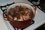 Coq au vin, a typical dish in French cuisine.