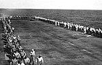 Crewmen jogging on the flight deck of USS Hollandia (CVE-97), in 1944-1945.jpg