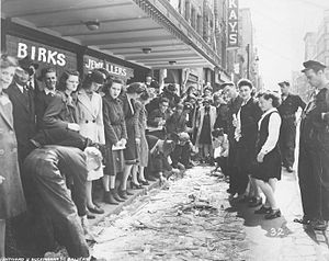 Bedford Magazine explosion - Image: Crowd viewing broken glass on Barrington St., Halifax, after the Bedford Magazine Explosion, 18 July, 1945