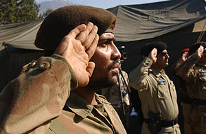 Salute - Pakistan army soldiers saluting British-style, palms facing outward.