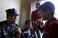 Defense.gov News Photo 100719-N-9643W-1219 - U.S. Navy Lt. Michael Quisao left plays the kazoo with a student from Escuela de Las Pampas during a community relations event with U.S. sailors.jpg