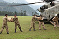 Defense.gov News Photo 100817-M-3497D-388 - U.S. Marines assigned to Marine Medium Helicopter Squadron 165 and to the 15th Marine Expeditionary Unit help Pakistani soldiers unload supplies.jpg
