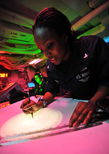 Defense.gov News Photo 110308-N-0569K-048 - Petty Officer 3rd Class Lakysha Brown uses the dead reckoning tracer to plot the ship s course and speed in the commanding officer s tactical plot.jpg