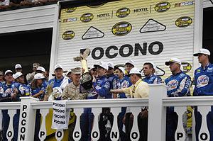 2007 Pennsylvania 500 - Kurt Busch holding the winner's trophy after winning the Pennsylvania 500.