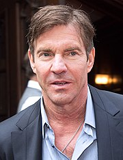 A shot of Dennis Quaid from his chest up, wearing a dress shirt and jacket.