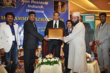 Dr. Najeeb Qasmi receiving memento from previous Indian Cricket Team Captain Mohammad Azharuddin on 8 April 2015.jpg
