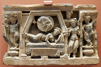 Jamal Garhi - Stupa drum panel showing the conception of the Buddha: Queen Maya dreams of a white elephant entering her right side, 100-300 AD, carved schist, Jamal Garhi, British Museum