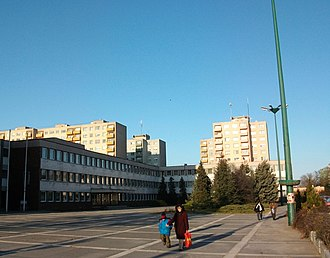 Dunaújváros - Városháza Square with typical concrete block of flats called Panelház