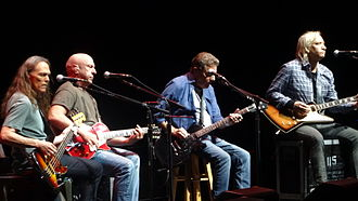 Eagles (band) - History of the Eagles tour, 2014, from left to right: Schmit, Leadon, Frey, and Walsh (Henley on drums not pictured).