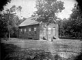 "Edgewood School, Wayne County, NC; ca 1900-1905. Pictured is a rural frame one-room school house. A handwritten ID label is affixed to the mounting card. Written on the mounting card is ""No. 4 Buck (19093908121).jpg"