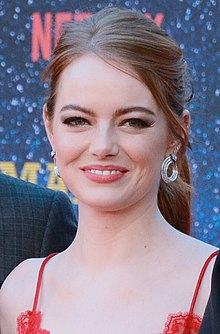 A picture of Emma Stone as she looks at the camera.