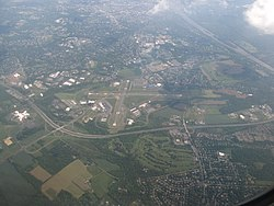 Aerial view of Ewing, looking southeast. Trenton-Mercer Airport, Interstate 295 and the Delaware River are prominent in the photo.