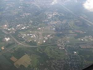 Ewing Township, New Jersey - Aerial view of Ewing, looking southeast. Trenton-Mercer Airport, Interstate 95 and the Delaware River are prominent in the photo.