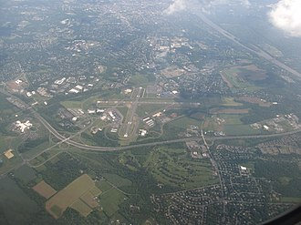 Ewing Township, New Jersey - Aerial view of Ewing, looking southeast. Trenton-Mercer Airport, Interstate 295 and the Delaware River are prominent in the photo.