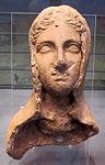 Ex-voto da stipe del cavone, testa femminile velata, III-II sec. ac. 01.jpg