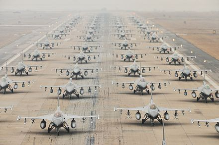 Taxi traffic F-16 Fighting Falcons demonstrate an 'Elephant Walk' as they taxi down the flightline at Kunsan Air Base, South Korea in 2012. - Republic of Korea Air Force