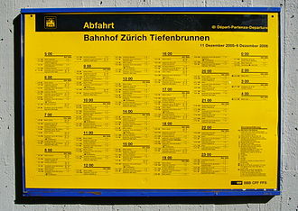 Public transport timetable - List of train departures in the form of a yellow poster (common in Europe) at Zürich Tiefenbrunnen railway station