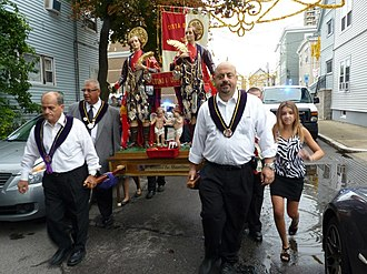 Feast of Saints Cosmas and Damian - Statues of Saints Cosmas and Damian are carried in East Cambridge on opening night of the feast in 2012