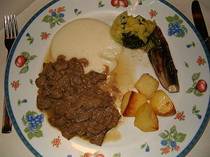 Cuisine of Veneto - Venetan liver, or fegato alla veneziana in Italian, served with potatoes and polenta.