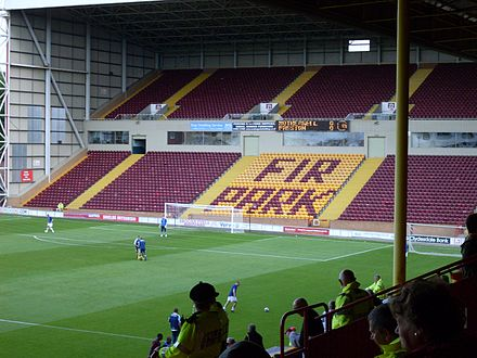 The South Stand is normally used for away supporters and is the largest stand at the ground. Fir Park.jpg