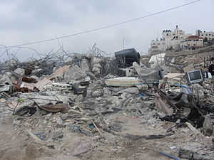 House demolition in the Israeli–Palestinian conflict - Demolished 2 apartment home of the 8-member Idris family, their relative, her husband and their two children (Beit Hanina, 2014)