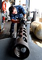 Flickr - Official U.S. Navy Imagery - A Sailor cleans a .50-caliber machine gun..jpg