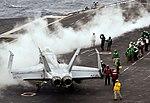 Flight deck crewmen prepare to launch an F-A-18C Hornet from the flight deck of the aircraft carrier USS Nimitz (CVN 68) on April 6, 2013 130406-N-LP801-170.jpg