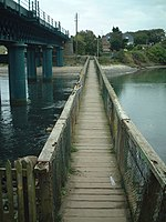 Footbridge at Laytown, Co. Meath This viewpoint was used in several postcards published in the 1900-1920 era, when the footbridge, built 1896-7, was still quite new.