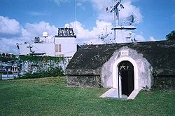 The frigate Ventôse can be seen behind the old fort