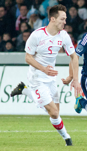 François Affolter - Affolter defends against Argentina in a friendly at Stade de Suisse on February 29, 2012