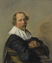 Portrait of a man leaning over the back of a chair