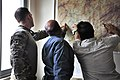 From left, U.S. Army 1st Lt. Patrick Gurski, with a security force assistance team (SFAT) with the 56th Infantry Brigade Combat Team, Texas Army National Guard, discusses operations with Afghan National Police 130604-A-FS372-004.jpg