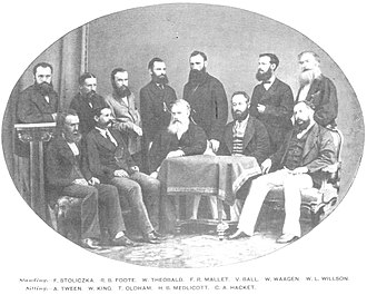 Henry Benedict Medlicott - Members of the Geological Survey of India, 1870: F. Stoliczka, R. B. Foote, W. Theobald, F. R. Mallet, V. Ball, W. Waagen, W. L. Willson (standing); A. Tween, W. King, T. Oldham, H. B. Medlicott, C. A. Hackett (sitting)