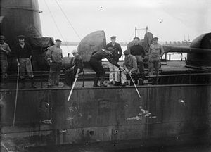 Scuttling of the German fleet in Scapa Flow - German sailors fishing over the side of a destroyer