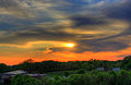 Gfp-southern-wisconsin-orange-sunset-behind-clouds-in-the-distance.jpg