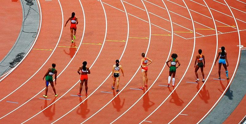 File:Girls racing on track (Unsplash).jpg