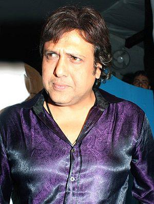Govinda, looking pensive in a purple satin shirt