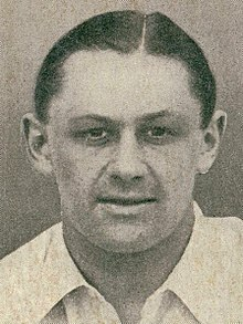 Headshot of a man in a white shirt