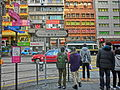 HK Yau Ma Tei Nathan Road finger signs view Sushi Take-Out shop Feb-2014 Traffic light crossway visitors.JPG
