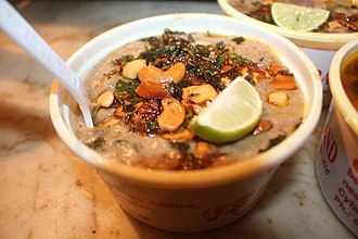 Haleem - Indian Hyderabadi haleem decorated with food salad.