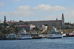 Harem car ferryboat piers with Selimiye Barracks in the background seen from Sea of Marmara.
