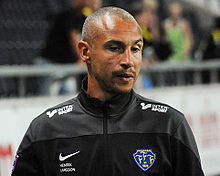 Henrik Larsson, wearing a tracksuit top, taking training