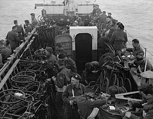 Highland Light Infantry of Canada - Infantrymen of the Highland Light Infantry of Canada aboard a landing craft en route to France on D-Day. LCI(L) 306th of the 2nd Canadian (262nd RN) Flotilla