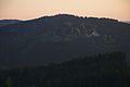 Horský hotel Jelenovská při západu slunce z rozhledny Královec, okres Zlín.jpg