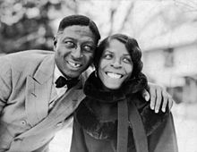 Lead Belly, on the left, with his arm around and Martha.