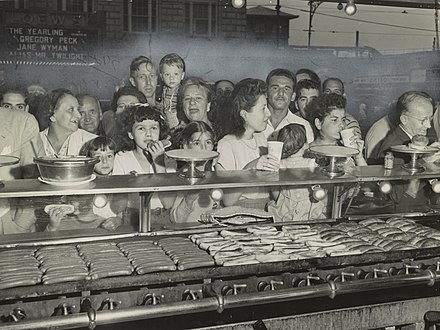"Crowding customers in 1947 Hungry ""hoard"" inside Nathan's (05428u).jpg"