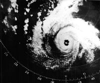 A radar image depicting a mature and well-formed storm, with a pronounced eye at the center and curved bands.